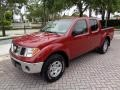 Nissan Frontier SE Crew Cab 4x4 Red Brawn photo #1