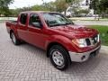 Nissan Frontier SE Crew Cab 4x4 Red Brawn photo #14