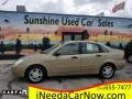 Ford Focus SE Sedan Fort Knox Gold Metallic photo #1