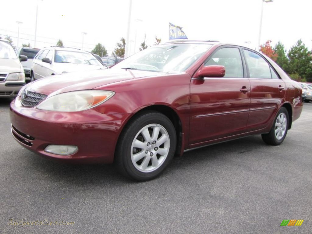 2003 toyota camry le v6 in salsa red pearl 059697 jax sports cars cars for sale in florida. Black Bedroom Furniture Sets. Home Design Ideas