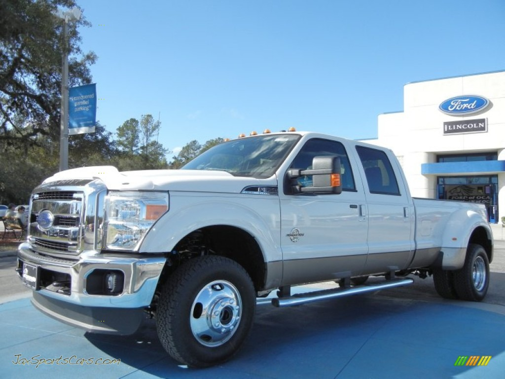 White platinum metallic tri coat black ford f350 super duty lariat crew cab 4x4