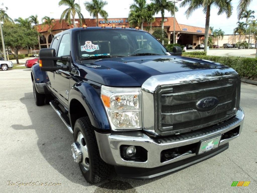 Dark blue pearl black two tone ford f450 super duty lariat crew cab 4x4 dually